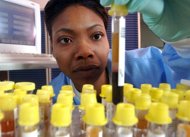 Senior Airman Shavone Simmons checks specimens before running a test at Yokota Air Base, Japan, on Thursday, May 11, 2006. Airman Simmons is a medical laboratory technician with the 374th Medical Group. Her laboratory performs more than 48,000 tests annually.