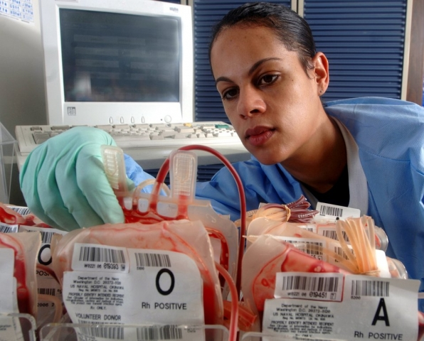 Tech. Sgt. Leyla Gillett checks units of blood for clots, leaks and broken segments during a daily inspection at Yokota Air Base, Japan, on Thursday, May 11, 2006. Sergeant Gillett is a medical laboratory technician with the 374th Medical Group. Her laboratory conducts more than 48,000 tests annually.